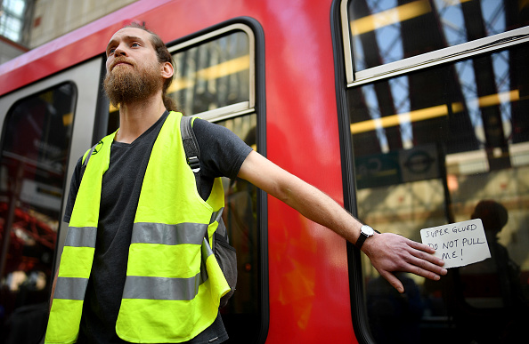 Hundreds Arrested In London As Eco-Protestors Glue Themselves To Trains